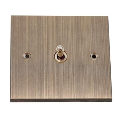Un interrupteur de luxe en bronze en accord avec votre intérieur